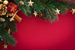 Christmas card with baubles, gift and fir tree Royalty Free Stock Photo
