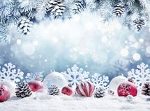 Christmas Card - Baubles On Snow. With Snowy Fir Branches royalty free stock photography
