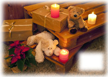 Christmas card with bears and candles Stock Images