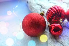 Christmas card. Beautiful Christmas background. Lots of red balls big and small on blue texture background. White snowflakes circl. Ing, the effect of falling royalty free stock image
