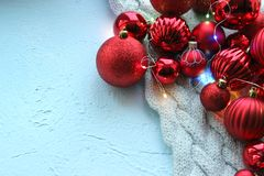 Christmas card. Beautiful Christmas background. Lots of red balls big and small on blue texture background. White snowflakes circl. Ing, the effect of falling stock images