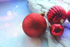 Christmas card. Beautiful Christmas background. Lots of red balls big and small on blue texture background. White snowflakes circl. Ing, the effect of falling stock photo