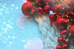 Christmas card. Beautiful Christmas background. Lots of red balls big and small on blue texture background. White snowflakes circl. Ing, the effect of falling stock photos