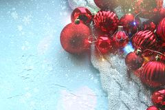 Christmas card. Beautiful Christmas background. Lots of red balls big and small on blue texture background. White snowflakes circl. Ing, the effect of falling royalty free stock photos