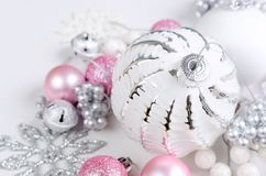 Christmas card with beautiful pink and white décorations. Variety pink and white Christmas holiday decoration, ball and toys on a white background, Christmas royalty free stock photo
