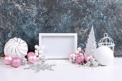 Christmas card with beautiful pink and white decorations. Empty frame, pink and white Christmas holiday decoration, ball and toys on a dark background, Christmas royalty free stock photo