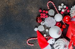 Christmas card with beautiful red and white decorations. Red and white gifts boxes with ribbon and holiday decoration, ball and toys on a dark background royalty free stock image
