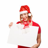 Christmas card. Beautiful young woman in christmas suit holding advertisement isolated on white background Royalty Free Stock Photos