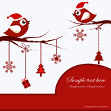 Christmas Card with Birds. Christmas card with red birds on branches with Christmas toys on a white background Royalty Free Stock Images