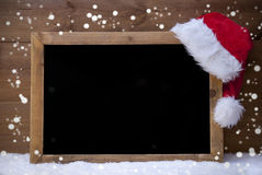 Christmas Card, Blackboard, Snow, Hat, Copy Space, Snowflakes Stock Photo