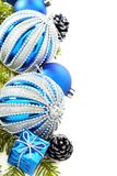 Christmas card with blue balls and cones. Stock Photos