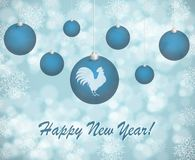 Christmas card with blue balls on a snowy background. Christmas card with blue balls with rooster on a snowy background stock illustration