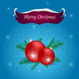 Christmas card with blue and red banner snow lying on it, red balls on Christmas tree branches. For greetings, invitations and pri Royalty Free Stock Images