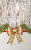Christmas card with bow, ribbon and fir branches Royalty Free Stock Images