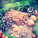 Christmas Card. Bunch with Cinnamon Sticks. Toned Royalty Free Stock Photo