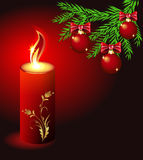 Christmas card with a burning candle Royalty Free Stock Photo