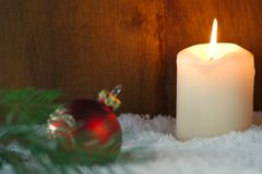 Christmas card with burning candle. And Christmas tree decoration Royalty Free Stock Photography