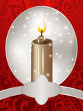 Christmas card with a candle Stock Photography