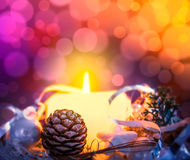 Christmas card with  candle, spruce buds and scenery on  bokeh Stock Photo