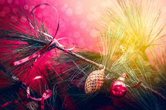 Christmas card with  candle, spruce buds and scenery on  bokeh Royalty Free Stock Photography