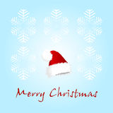 Christmas card with a cap Royalty Free Stock Images