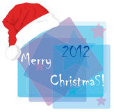 Christmas card with a cap of Santa Claus. Royalty Free Stock Image