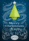 Christmas card with chalkboard and origami tree. Christmas card with blue chalkboard and origami tree Stock Photo
