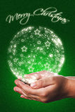 Christmas card with a child hands in green Stock Images