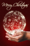 Christmas card with a child hands in red Stock Images