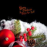 Christmas card with Christmas balls on a dark background Stock Images