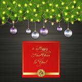 Christmas tree, Christmas ball, garland, gold bow. Christmas card Christmas balls, garland and branches of Christmas tree on black wooden desk. Christmas Royalty Free Stock Image