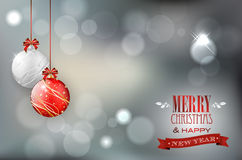 Christmas card with christmas balls on shiny background Stock Images