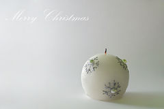 Photo of a christmas candle on a simple and elegant background Stock Photo
