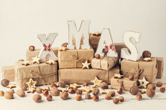 Christmas card. Christmas cookie, nuts and gifts with wooden dec. Oration letters - XMAS. Vintage stile Royalty Free Stock Photos