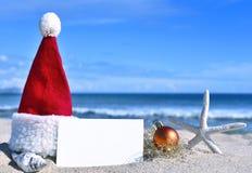 Christmas card with christmas decoration. Merry Christmas card with christmas decoration and sea shell on a tropical beach. Christmas holidays. Blank greeting Stock Photos