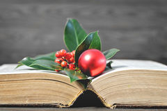 Christmas card with Christmas decoration and old book. On wooden background Royalty Free Stock Images