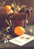 Christmas Card with Christmas decoration, oranges and pine cones. Selective focus Royalty Free Stock Photography