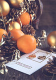 Christmas Card with Christmas decoration, oranges and pine cones. Toned image Royalty Free Stock Images