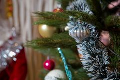 Christmas card. Christmas. New Year. One red ball, fir-tree toy on the Christmas tree. on a light background. Bright lights. mock Royalty Free Stock Photo