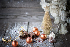 Christmas card with Christmas tree, chocolates on wooden board. Royalty Free Stock Photography