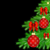 Christmas card with Christmas tree decorations. Red Christmas baubles with red bow on Christmas tree over black background Royalty Free Stock Photo
