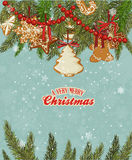 Christmas card with christmas tree and gingerbread on snowflakes background in vintage style. Stock Photos