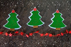 Christmas card. Christmas tree made of felt and decorative stars. Stock Image