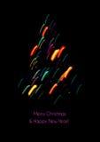 Christmas card with a christmas tree shape made of lights. Christmas card with a christmas tree shape made of colored lights. Bright colors on a black background Stock Photo