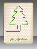 Christmas card with christmas tree shaped paper clip Stock Images
