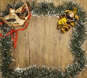 Christmas card from Christmas trees with masquerade mask and Christmas decorations. Royalty Free Stock Photo