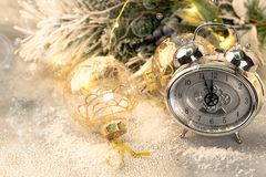 Christmas card with clock and christmas ornament, selective focus and square image stock images
