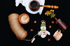 Christmas card with coffee and snowman. Cup of hot drink. Holiday Christmas concept. Nuts, a bouquet of flowers, Christmas toy sno Royalty Free Stock Photography