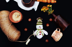 Christmas card with coffee and snowman. Cup of hot drink. Holiday Christmas concept. Nuts, a bouquet of flowers, Christmas toy sno Stock Photos