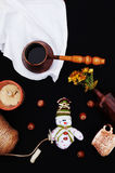Christmas card with coffee and snowman. Cup of hot drink. Holiday Christmas concept. Nuts, a bouquet of flowers, Christmas toy sno Royalty Free Stock Photos